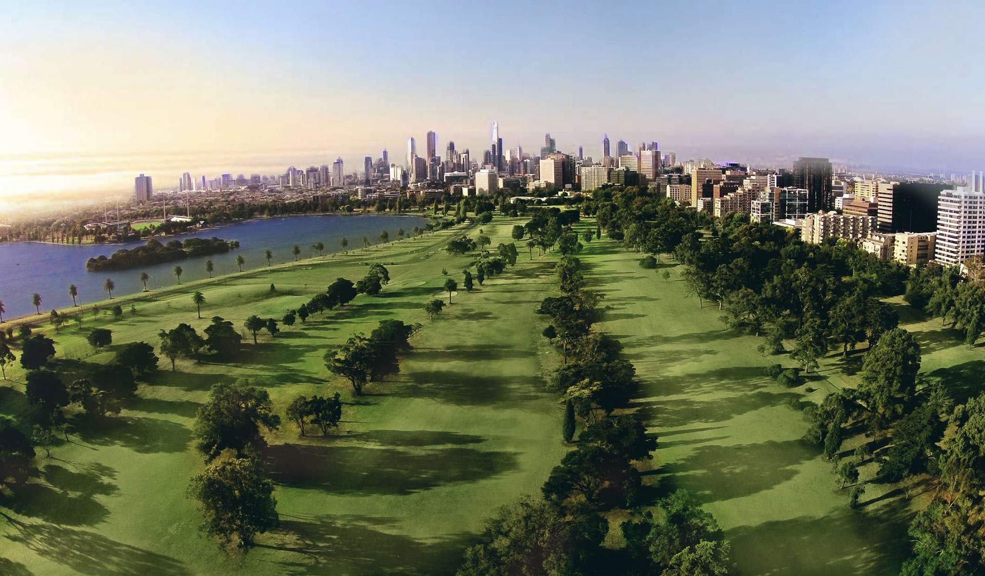 Albert Park Golf Course with views of Melbourne's CBD skyline in the background.