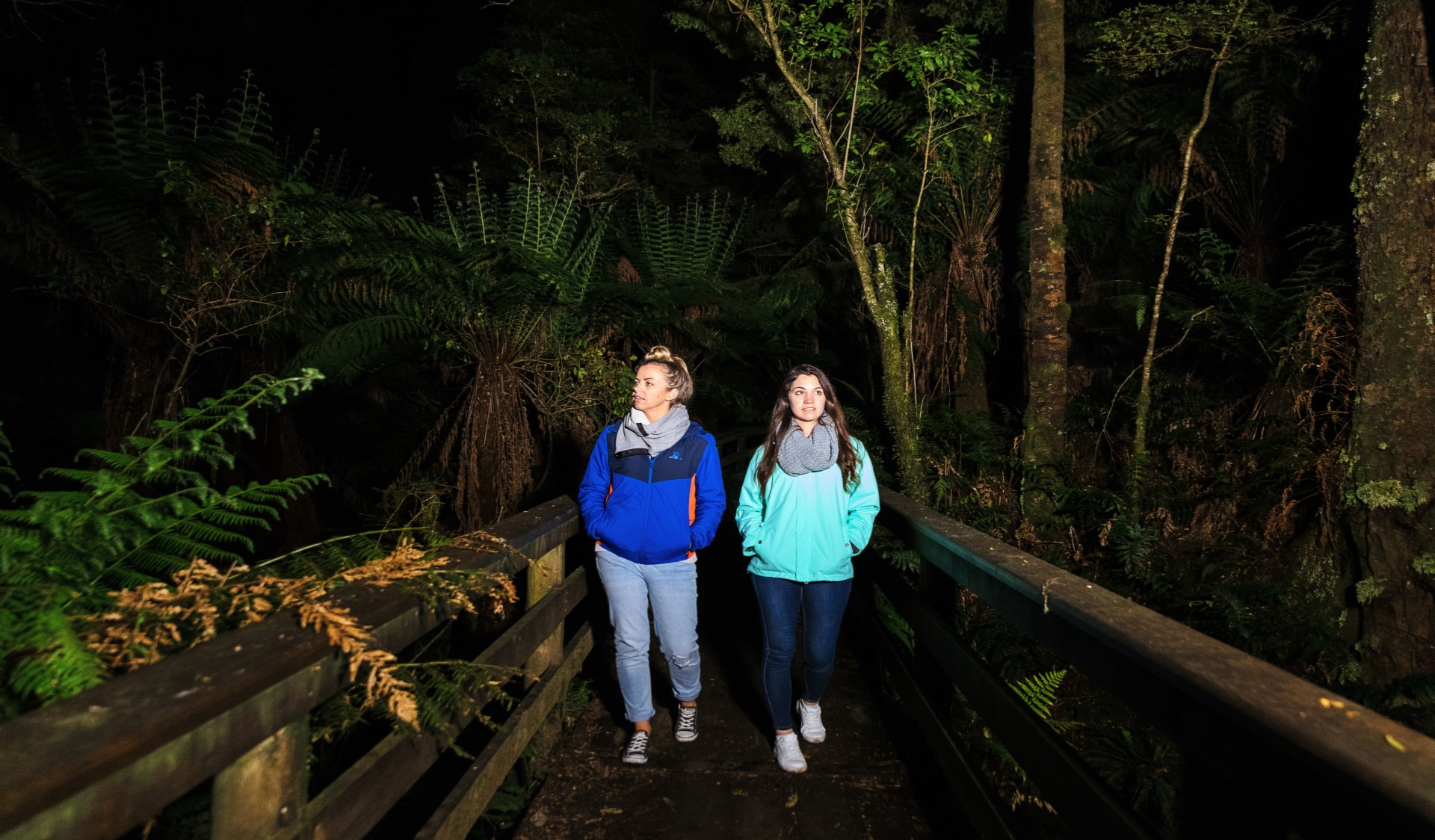 Two girls glowworm spotting at Melba Gully in Great Otway National Park