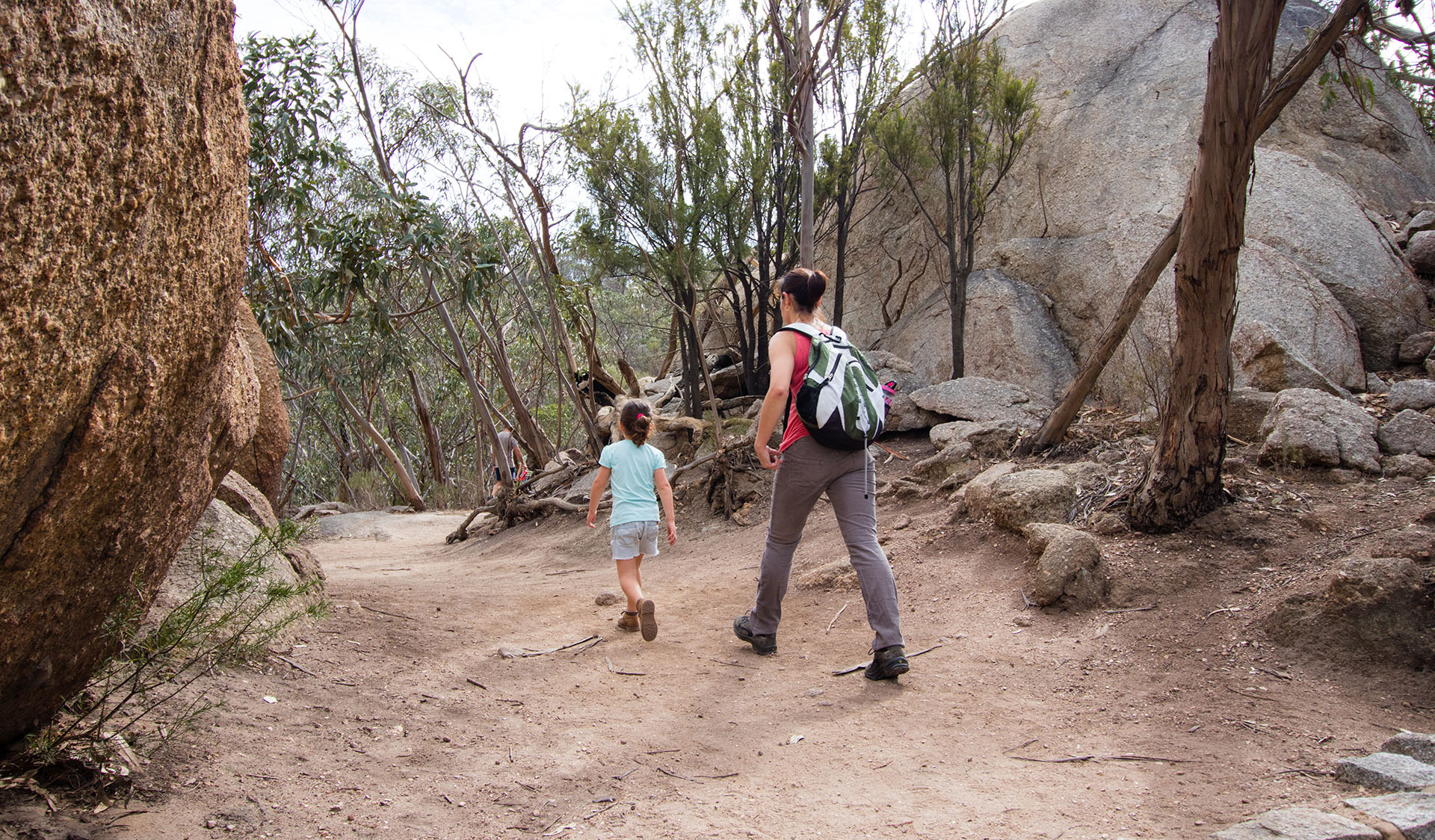 Woman and child hiking along a trail in You Yangs Regional Park