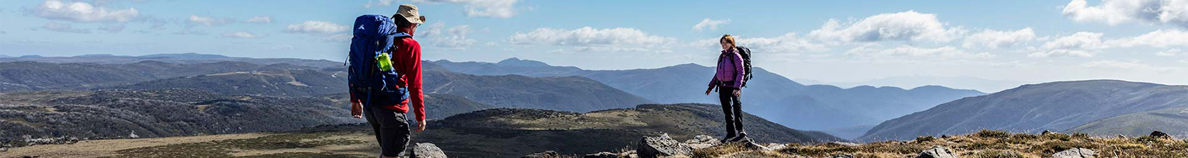 Two hikers reach the summit of Mount Nelse at Bogong High Plains