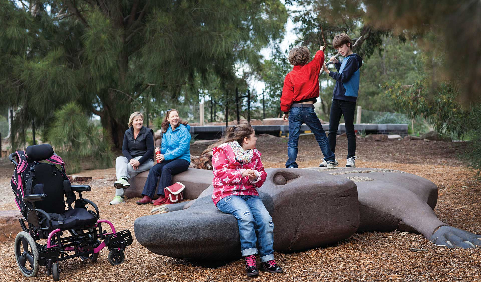 A family plays at the Brimbank Playscape