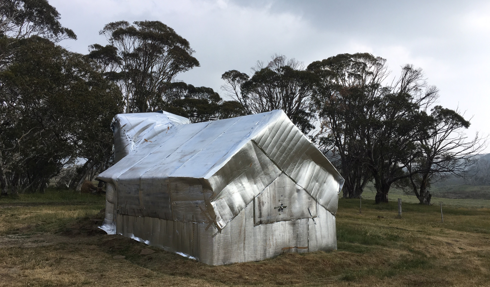 High country hut wrapped in foil