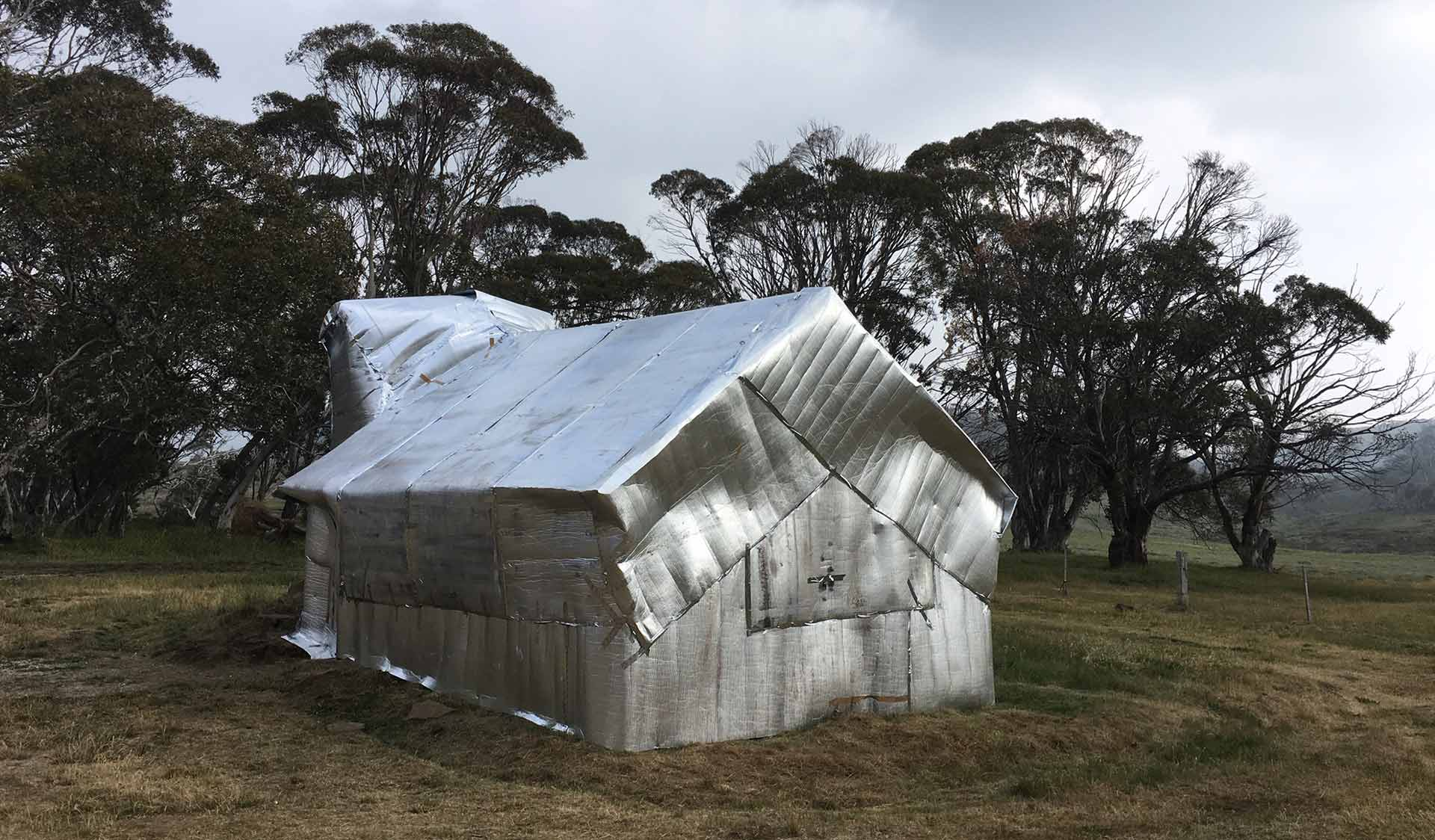 Wrapping high country hut