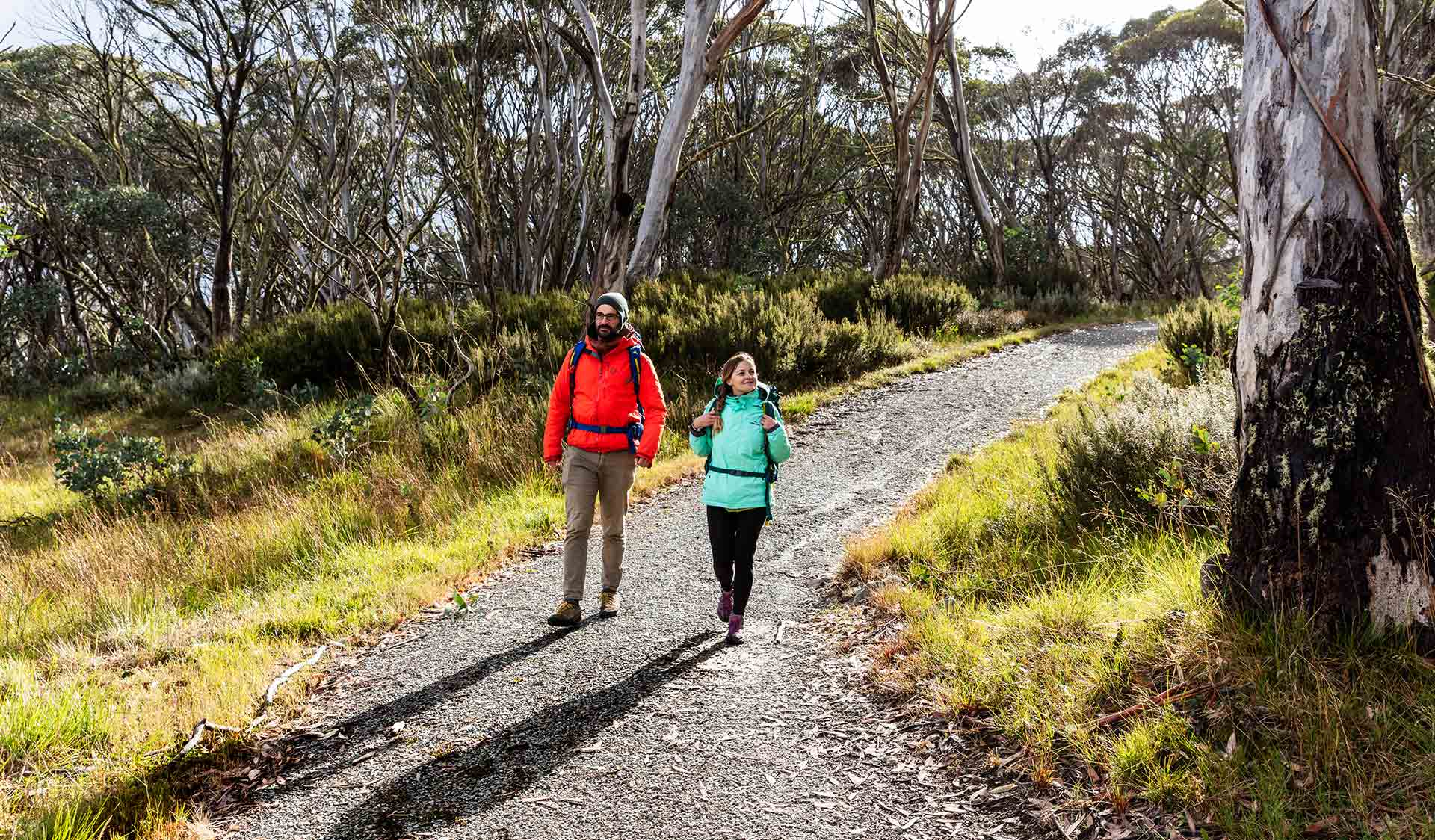 Two friends walk along the Brabralung Trail near Dinner Plain in the Alpine National Park.