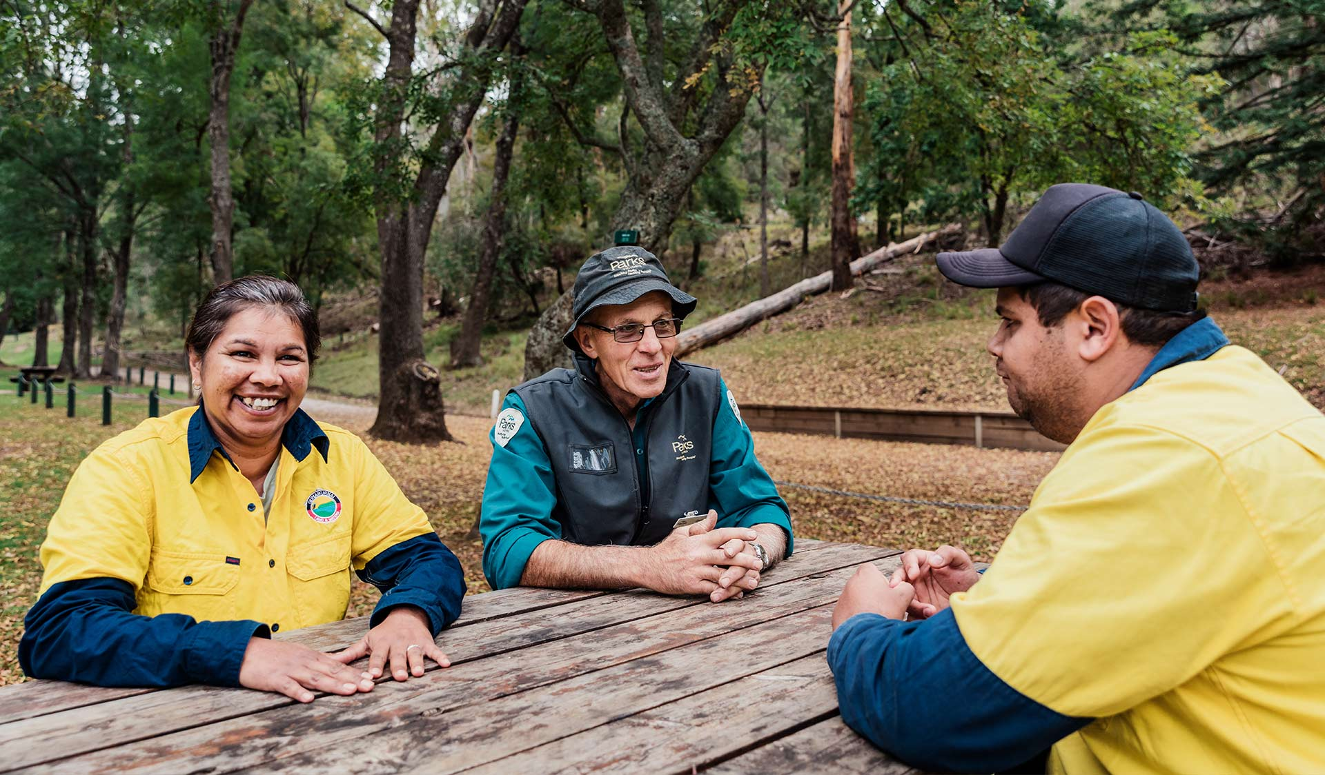 Representatives from the Gunaikurnai Land and Water Aboriginal Corporation sit with Parks Victoria Rangers at Buchan Caves Reserve.
