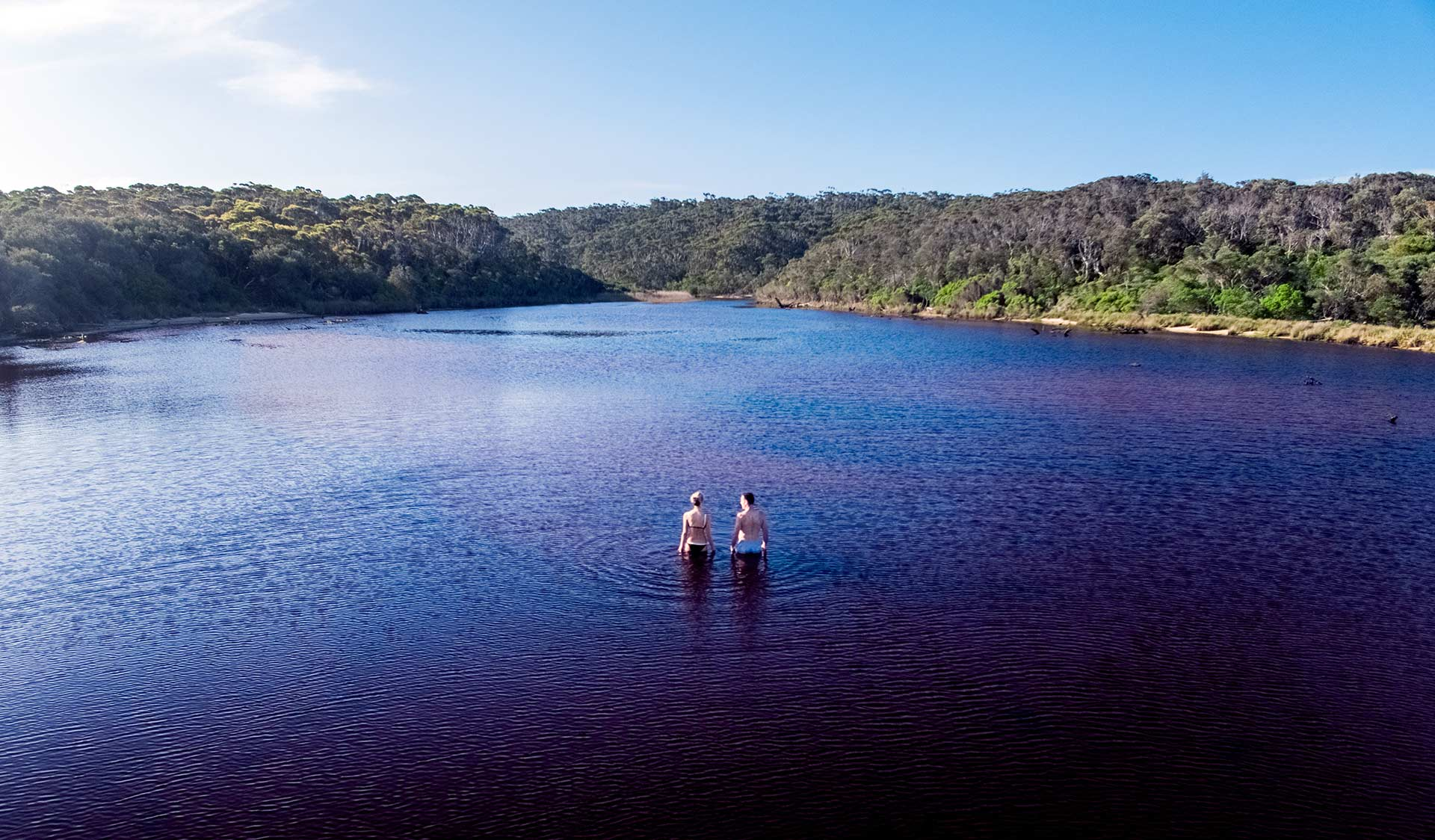 Two friends go for a swim in Lake Elusive in Croajingolong National Park.