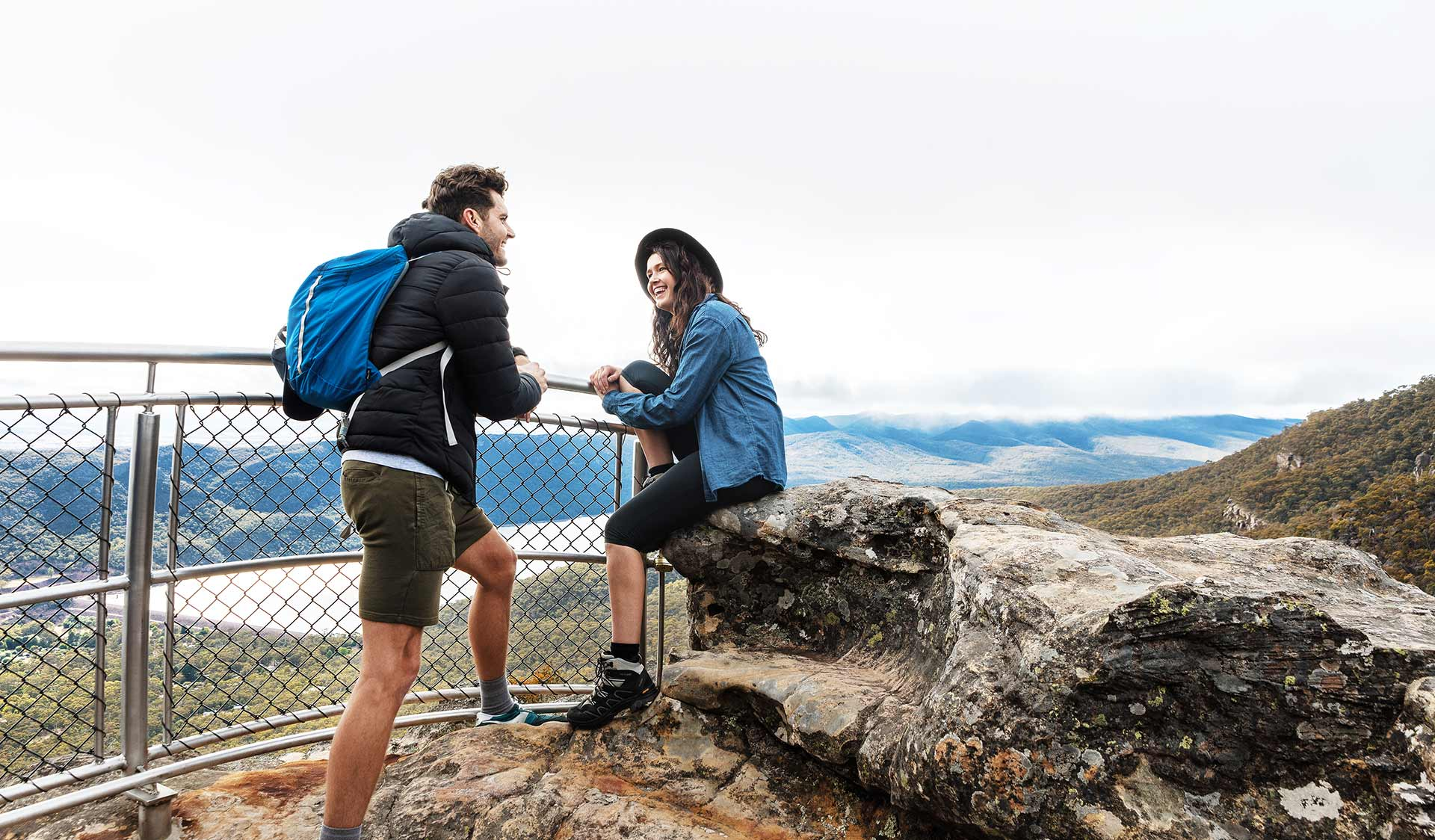 A couple in their twenties chat at the Lakeview lookout in the Grampians National Park.