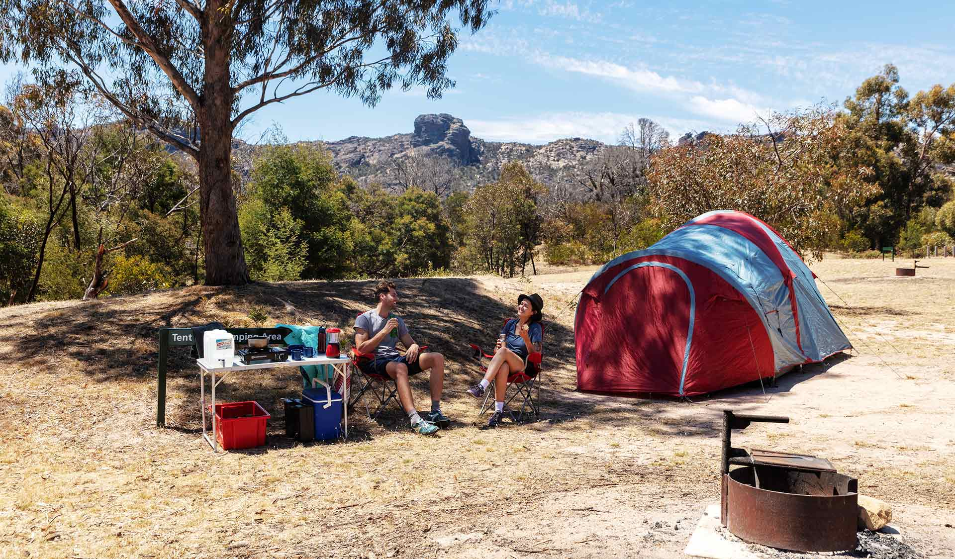 A couple in their twenties camp at the Mt Stapylton Campground in the Grampians National Park.