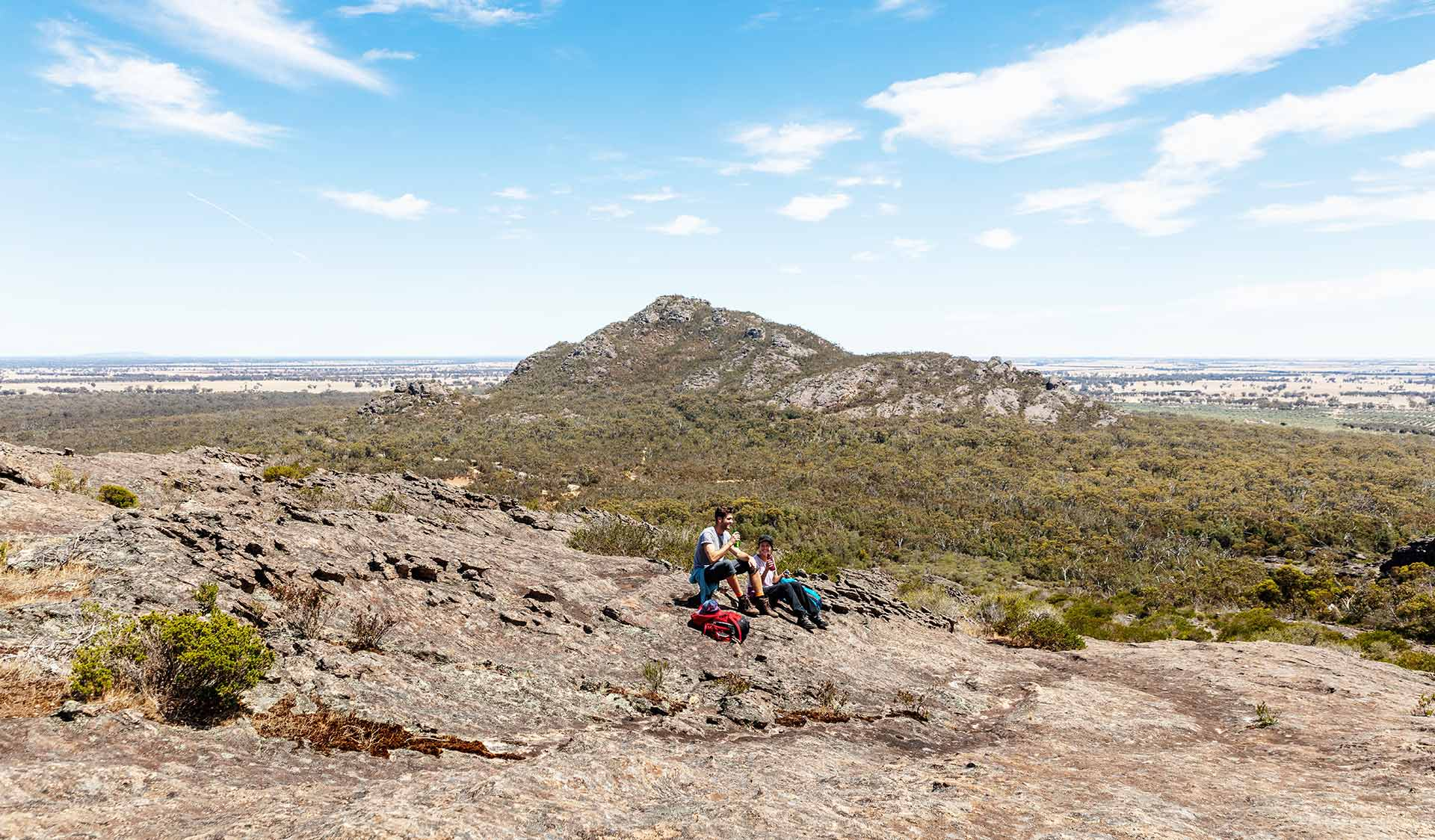 Two people stop for a picnic in front of Mount Zero in the Northern Grampians.
