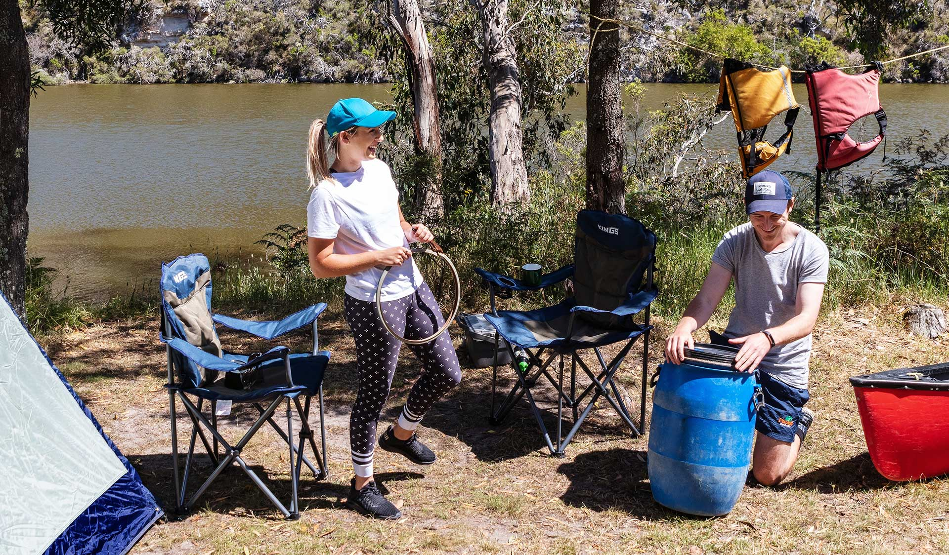 A couple unpack their waterproof barrel at a campsite in the Lower Glenelg National Park.