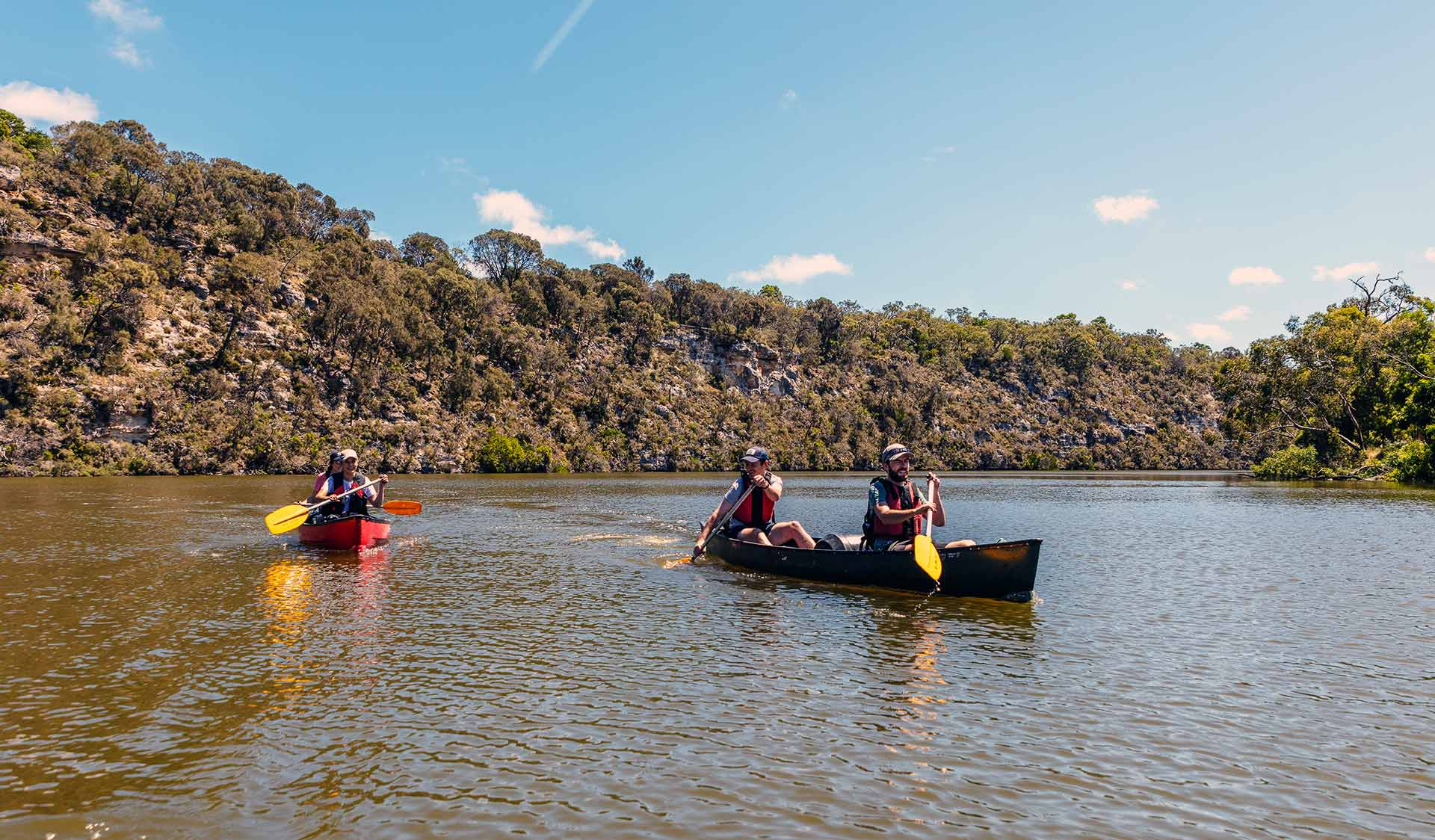 Four friend canoe down the Glenelg River in the Lower Glenelg National Park.