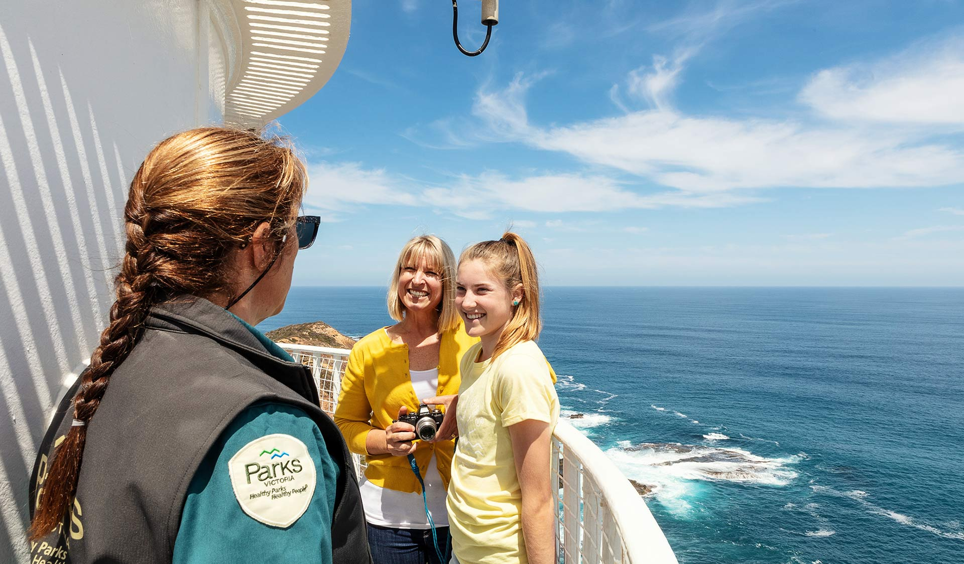 A mother and daughter talking to a Parks Victoria Ranger at the Cape Schanck Lighthouse