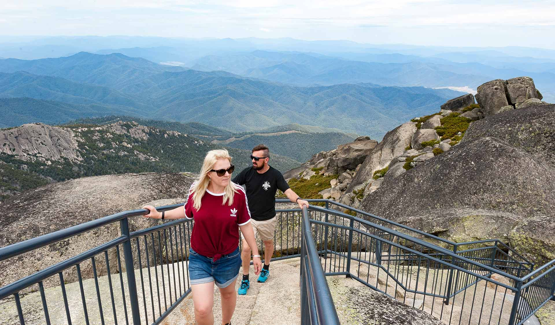 A couple in their thirties approach the summit lookout at the Horn of Mount Buffalo.