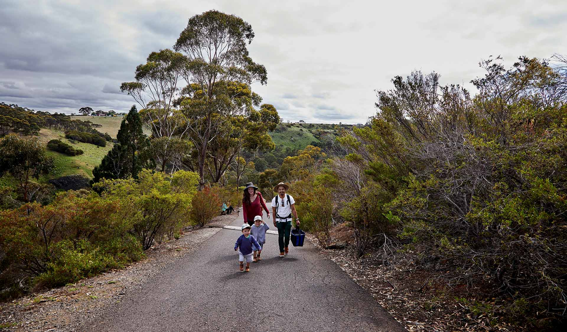 A family walk through the Organ Pipes National Park on the way to a picnic spot.
