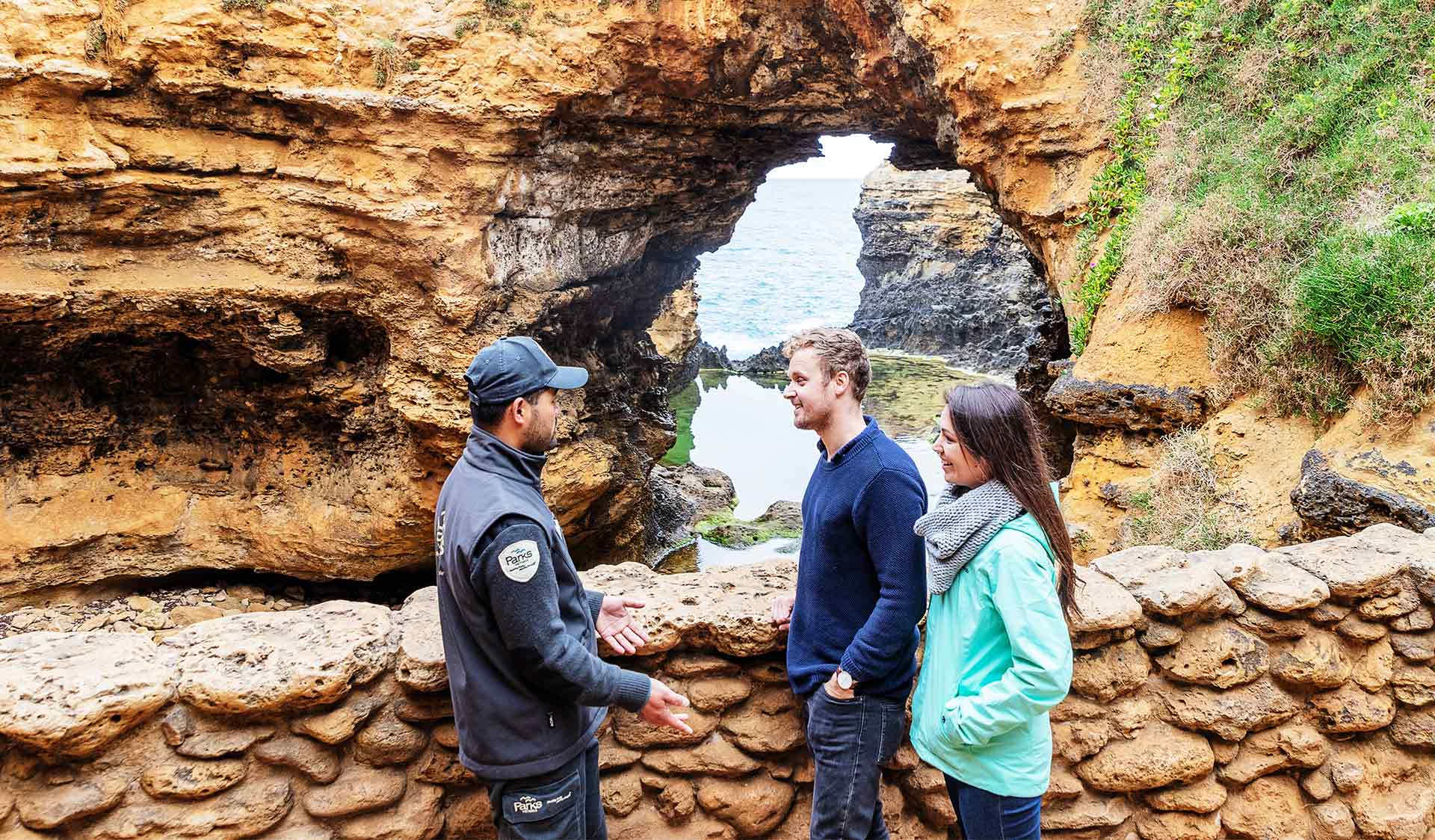A couple talking to a Parks Victoria Ranger at The Grotto in Port Campbell National Park