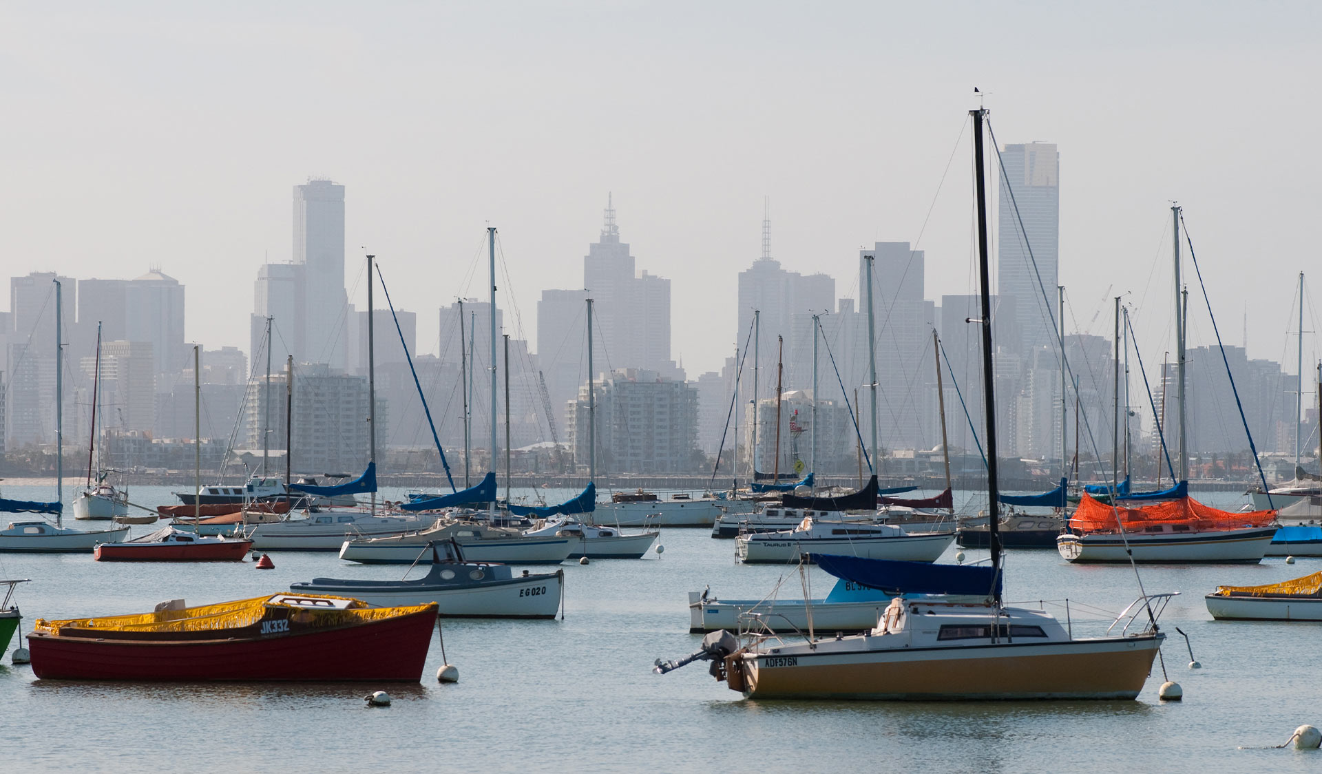 Boats moored in Port Phillip in front of Melbourne's skyline.