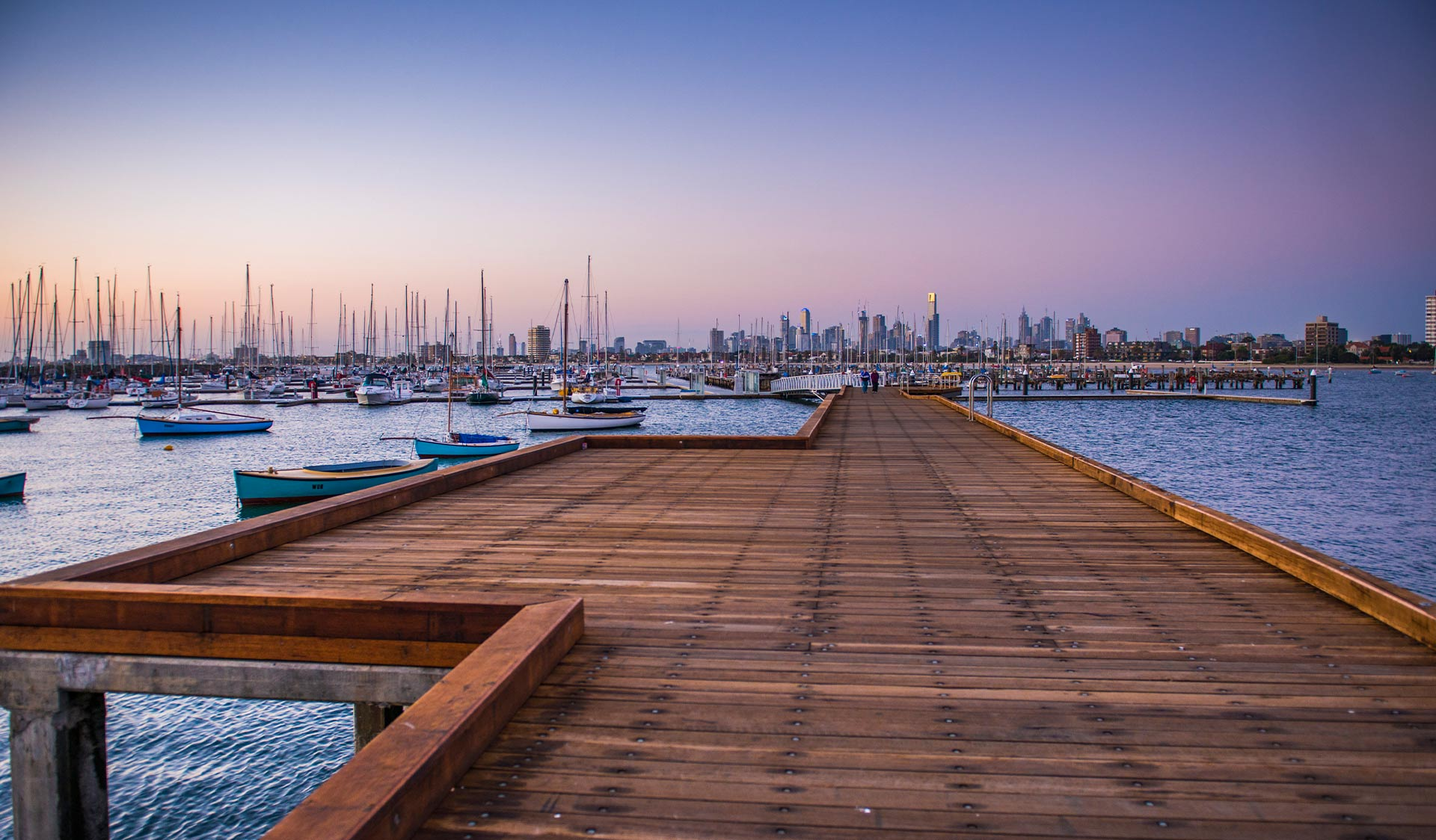 Sunset on St Kilda Pier with views of the CBD in the background.