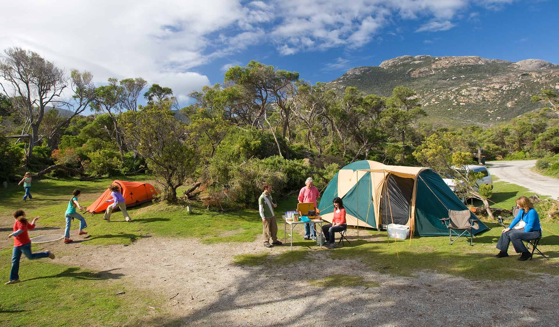 A family set up camp at Tidal River Camp Ground at Wilsons Promontory National Park.