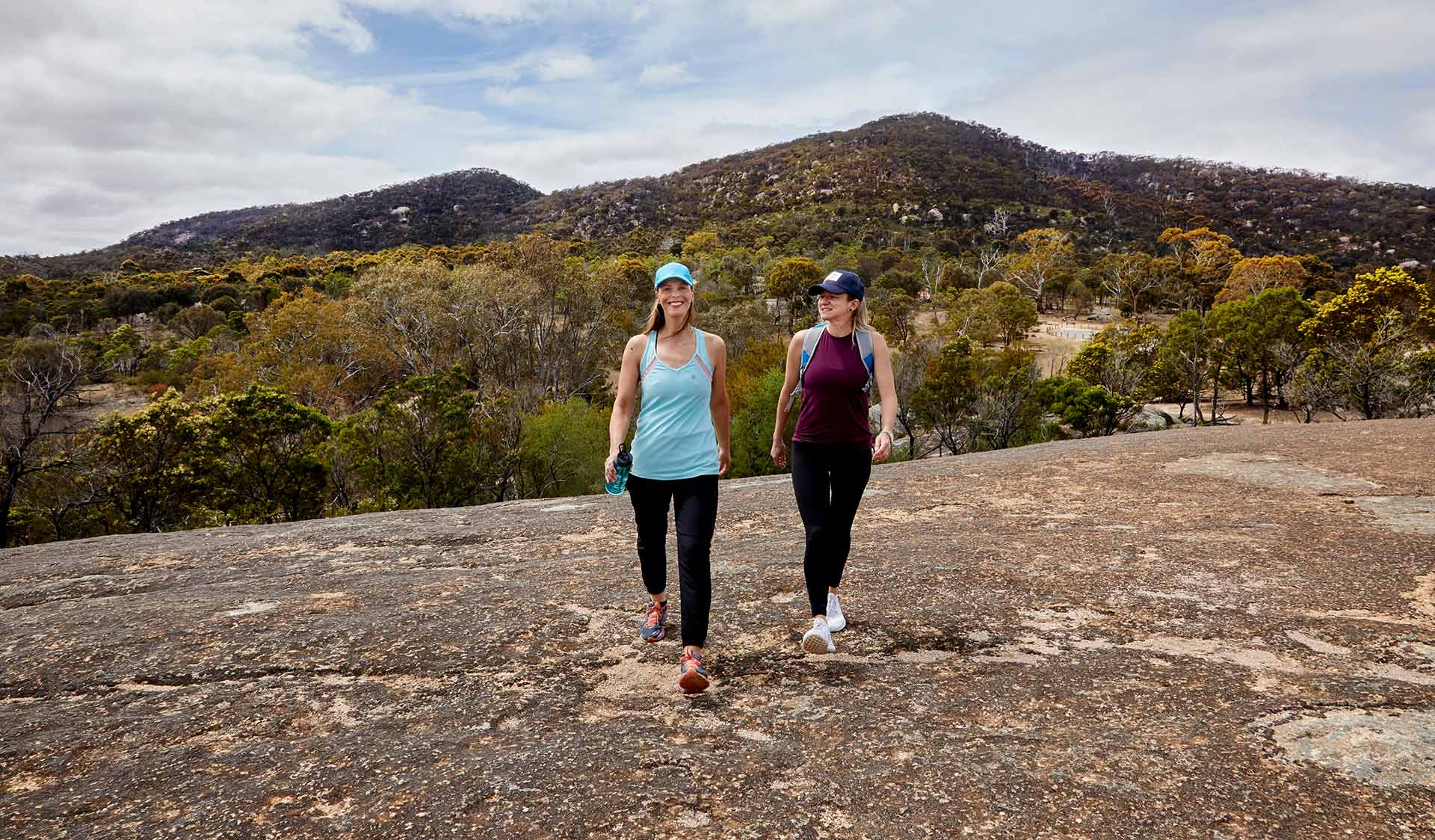 Two women walking for fitness at Big Rock in You Yangs Regional Park