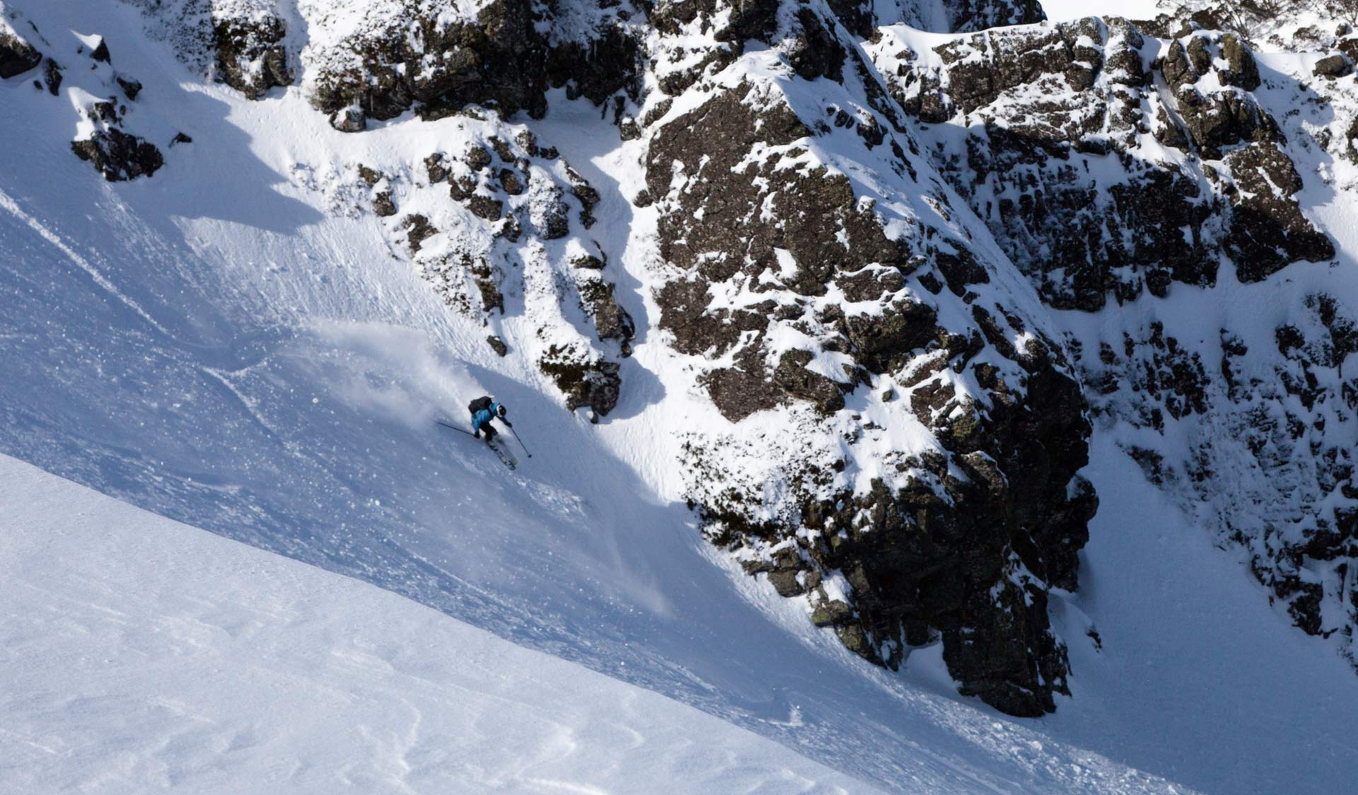 A ski-mountaineer tackles a steep slope on the side of Mt Bogong.