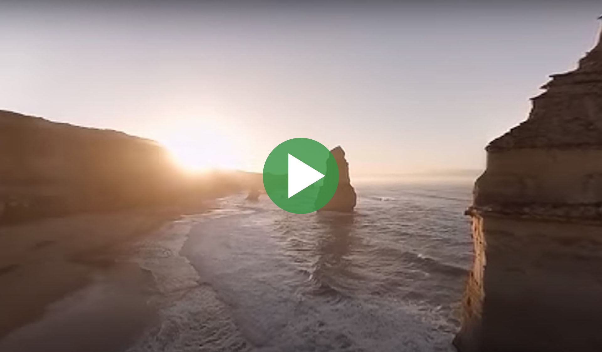 Still image from 360-degree time-lapse video of Twelve Apostles at Port Campbell National Park, with play icon overlay.